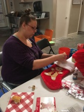 Harmony decorating stocking for City of Refuge's clients