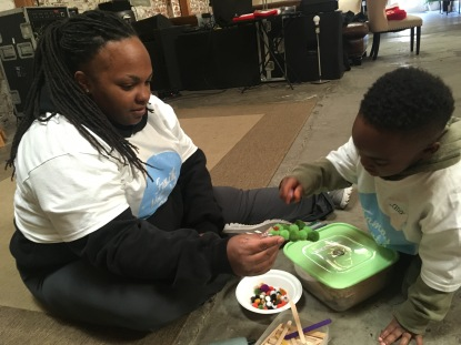 Genea and Langston teaming up to create Christmas tree decorations.